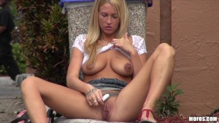 Big tit blonde teen whore fucks her pussy with a dildo in public