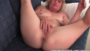 Grandma takes off her dress and spreads her old but suckable pussy wide